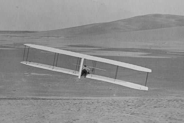 Wilbur Wright, mounted here on a plane, attempts a turn during testing in 1902